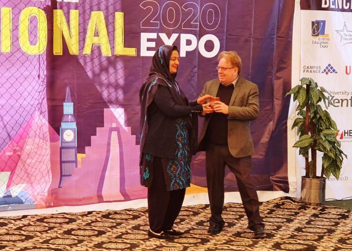 Alan receiving business gift in Pakistan